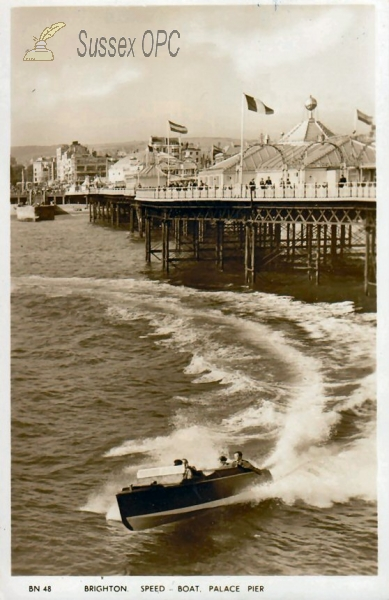 Image of Brighton - Speed boat and Palace Pier