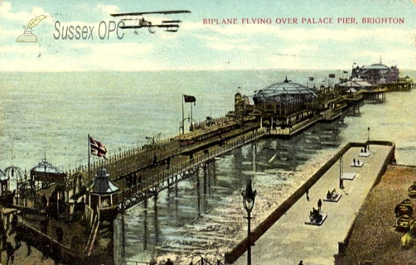 Hastings - Biplane over the Pier